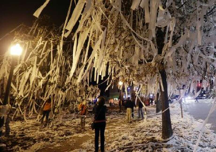 Auburn fans roll Toomer's Corner in Auburn, Ala., Saturday, Dec. 7, 2013 following a win over Missouri in the Southeastern Conference championship game.