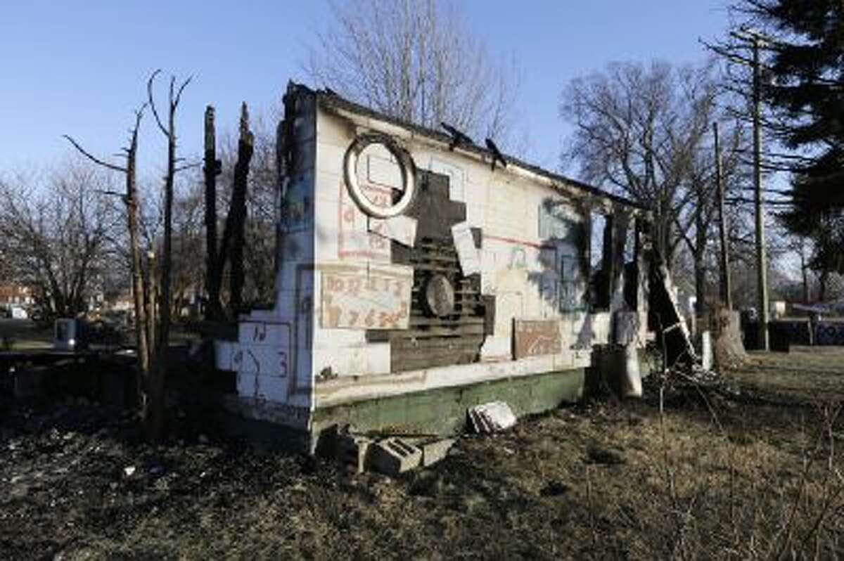 In a photo from Tuesday, Dec. 10, 2013 the remains of the Clock House at the Heidelberg Project in Detroit is seen.