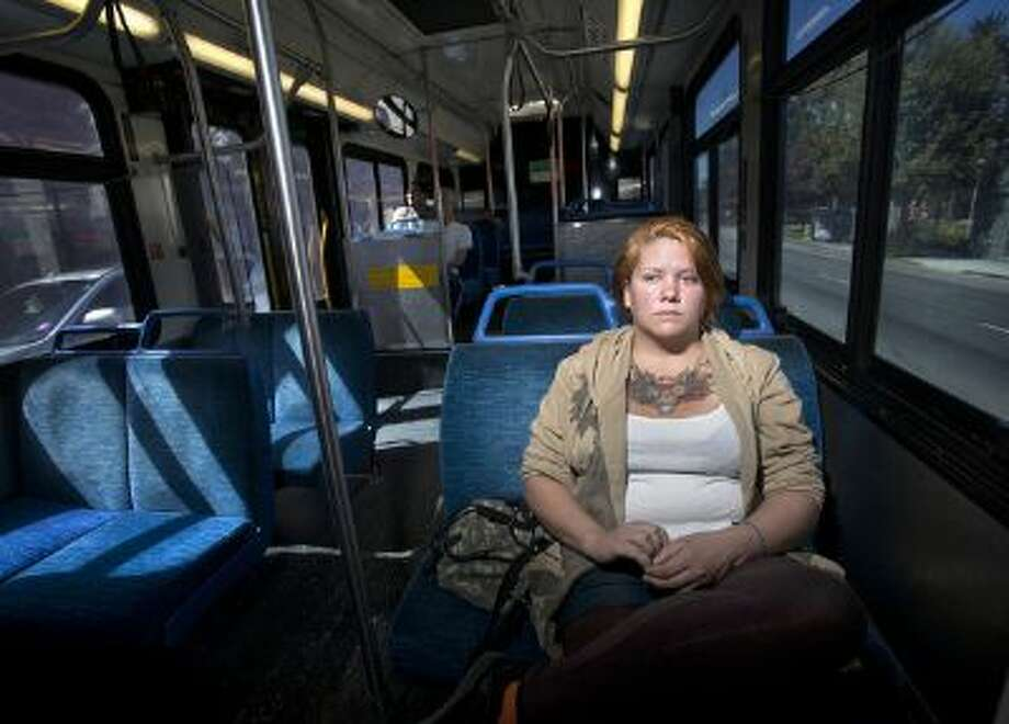 Bailey DeCarlo, 24, on the VTA No. 22 bus in downtown San Jose on Friday, Aug. 30, 2013. When she was homeless she says she sometimes rode the bus for hours to stay out of the elements and to sleep. She now has a job and is staying with family. Photo: Patrick Tehan / SJMN