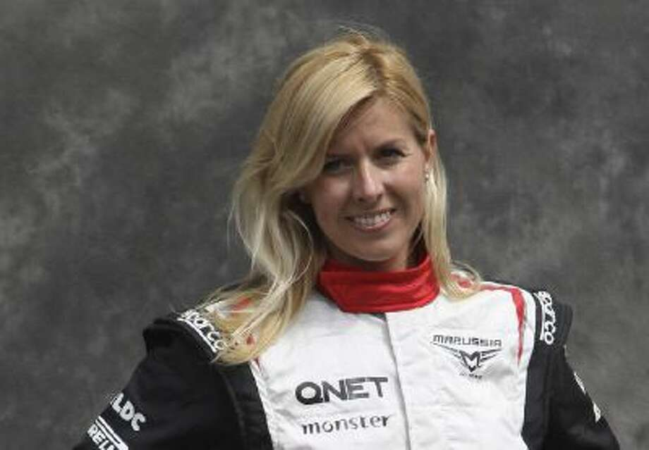 FILE - In this Thursday, March 15, 2012 file photo, Marussia test driver Maria de Villota of Spain poses for a photo ahead of the Australian Formula One Grand Prix at Albert Park in Melbourne, Australia. Spanish police have confirmed Friday Oct. 11, 2013 that racing driver Maria de Villota has been found dead in a hotel room in Seville, and say it appears she died of natural causes. She was 33.