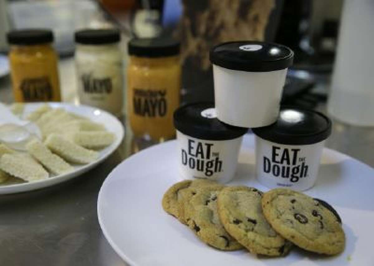 In this photo taken Tuesday, Dec. 3, 2013, plant-based products including chocolate chip cookies, cookie dough and mayonnaise are displayed at Hampton Creek Foods in San Francisco.