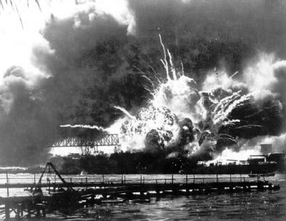 In this Dec. 7, 1941 file photo, the destroyer USS Shaw explodes after being hit by bombs during the Japanese surprise attack on Pearl Harbor, Hawaii.