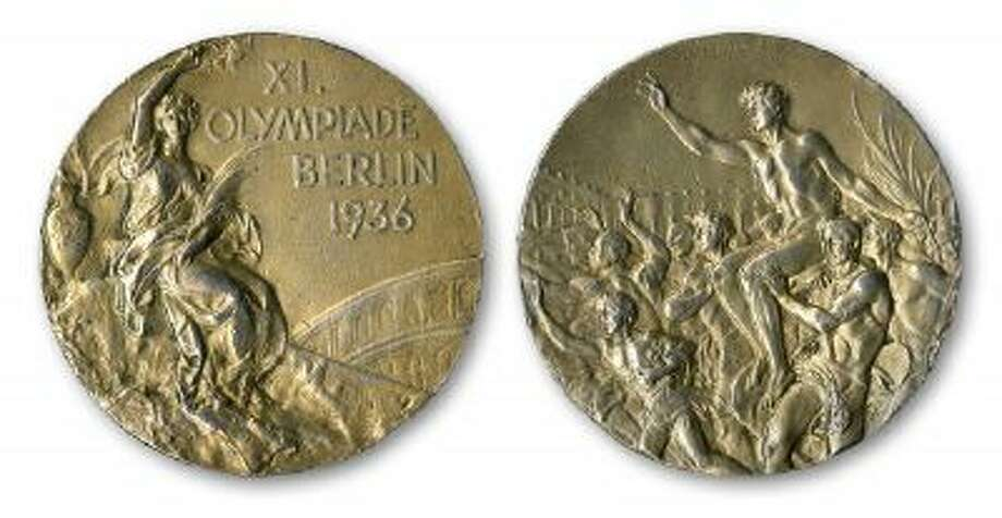 This handout provided by SCP Auctions, Inc., shows the front, left, and back, right, of one of Jesse Owens' four gold medals won at the 1936 Olympics in Berlin. SCP Auctions says the medal could go for more than $1 million when the auction opens.