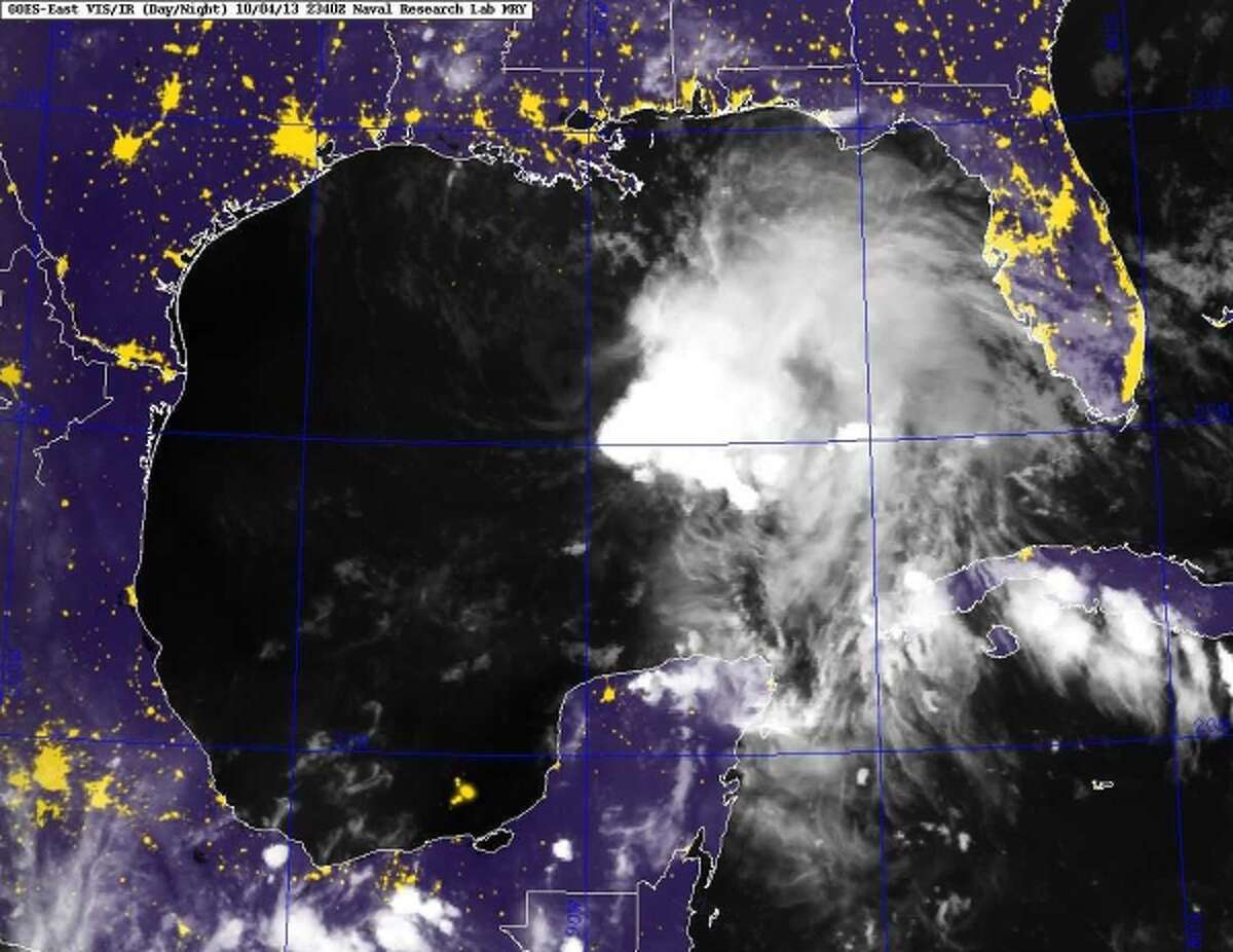This image provided by the Naval Research Laboratory shows a infrared satellite image taken at 7:40 p.m. EDT Friday Oct. 4, 2013 of Tropical Storm Karen. Karen continued losing strength Saturday as it headed toward the central Gulf Coast, but forecasters were still expecting it to bring significant rain and potential flooding to low-lying areas.
