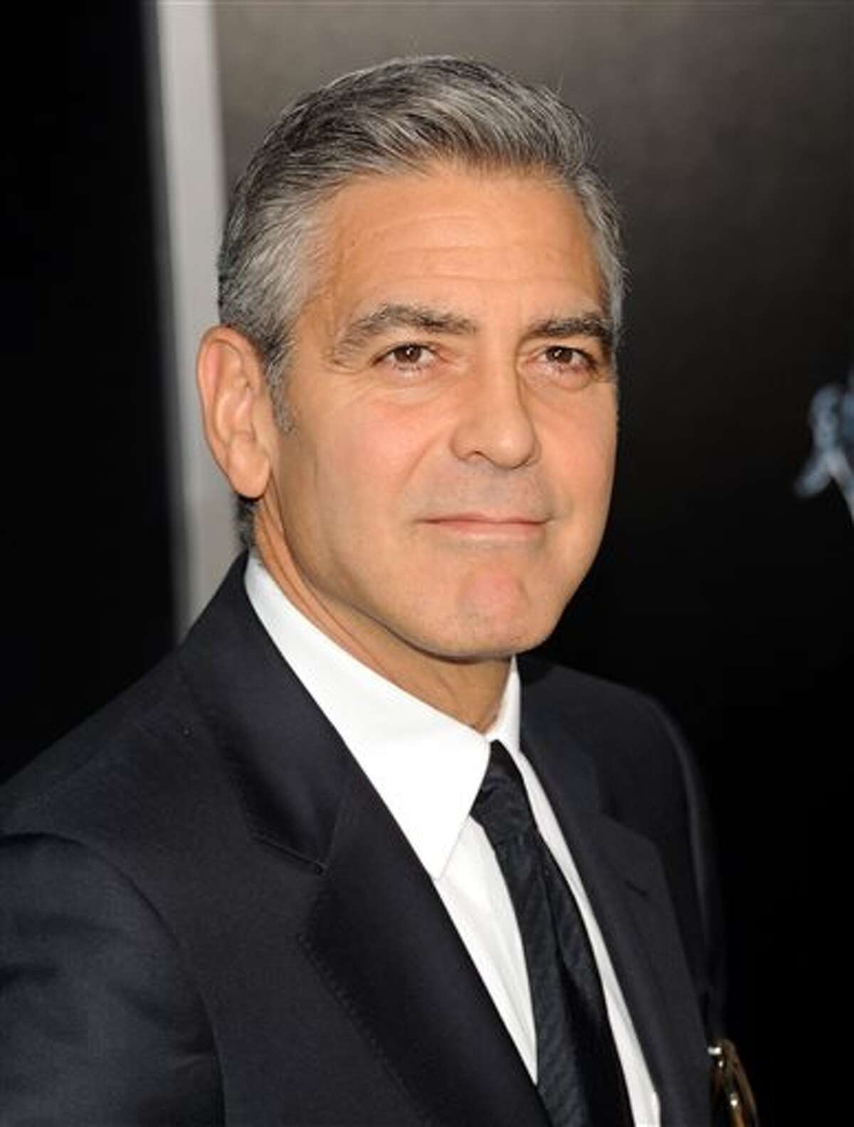 """Actor George Clooney attends the premiere of """"Gravity"""" at the AMC Lincoln Square Theaters on Tuesday, Oct. 1, 2013, in New York. (Photo by Evan Agostini/Invision/AP)"""
