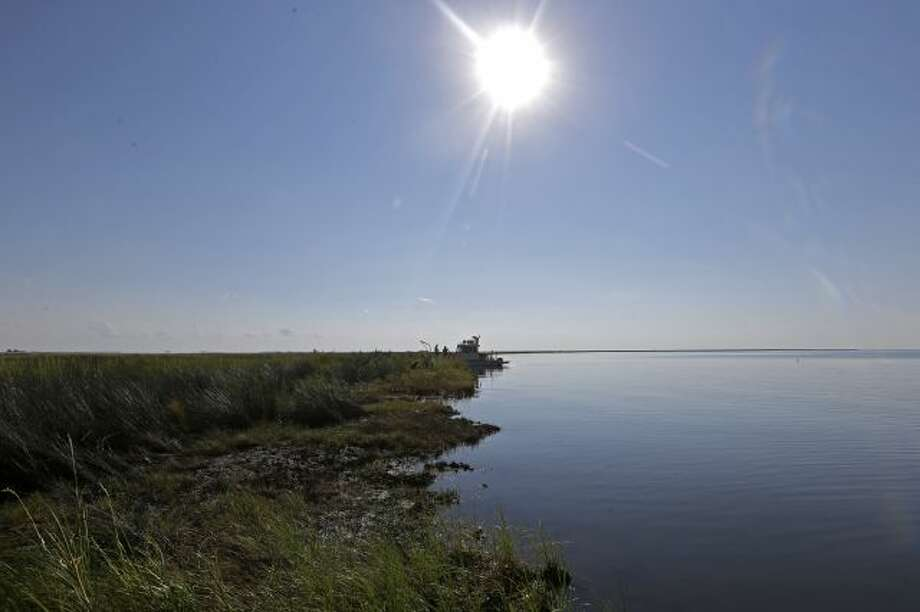 The shoreline of Bay Jimmy, which was heavily impacted by the Deepwater Horizon oil spill, is seen in an area that has tar mats and oozing crude oil on the marsh platform, in Plaquemines Parish, La., Friday, Sept. 27, 2013. The methods that BP employed during its 86-day struggle to stop oil gushing into the Gulf of Mexico will be the focus of a trial resuming Monday, Sept. 30, 2013 in New Orleans, in the high-stakes litigation spawned by the worst offshore spill in the United States.... Photo: AP / AP