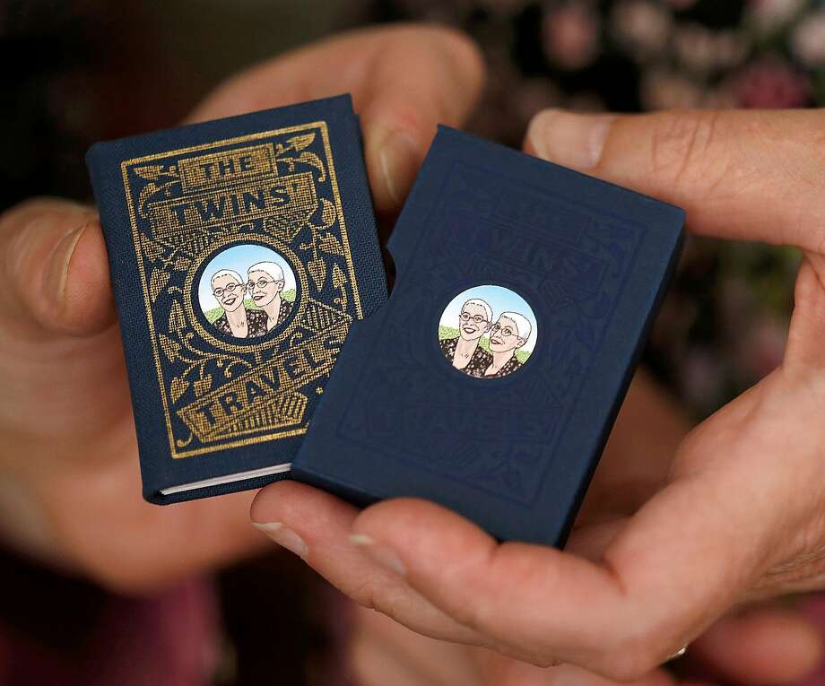"""The Twins' Travels,"" is a miniature book by Dorothy A. Yule, illustrated by Susan Hunt Yule. Photo: Liz Hafalia, The Chronicle"