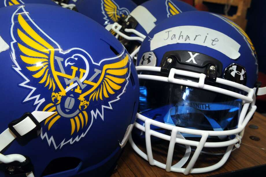 The Harding High School football team received new helmets for the upcoming season, in Bridgeport, Conn. Aug. 3, 2017. Photo: Ned Gerard / Hearst Connecticut Media / Connecticut Post