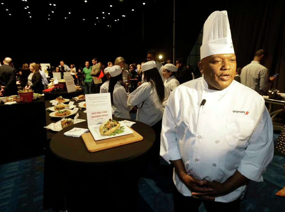 O'Brien Tingling, regional executive chef at Aramark Sports & Entertainment, talks about the food during the Aramark preview event of Super Bowl LI food and merchandise shown at George R. Brown Convention Center Tuesday, Jan. 24, 2017, in Houston.  ( Melissa Phillip / Houston Chronicle ) Photo: Melissa Phillip, Staff / © 2017 Houston Chronicle
