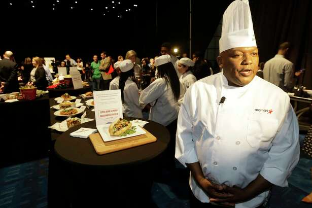 O'Brien Tingling, regional executive chef at Aramark Sports & Entertainment, talks about the food during the Aramark preview event of Super Bowl LI food and merchandise shown at George R. Brown Convention Center Tuesday, Jan. 24, 2017, in Houston.  ( Melissa Phillip / Houston Chronicle )