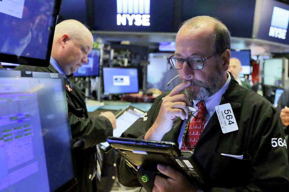 Trader Edward Landi, right, works on the floor of the New York Stock Exchange, Monday, Aug. 7, 2017. Stocks are little changed in early trading as technology companies rise and energy companies slip with the price of oil. (AP Photo/Richard Drew) ORG XMIT: NYRD101 Photo: Richard Drew / AP