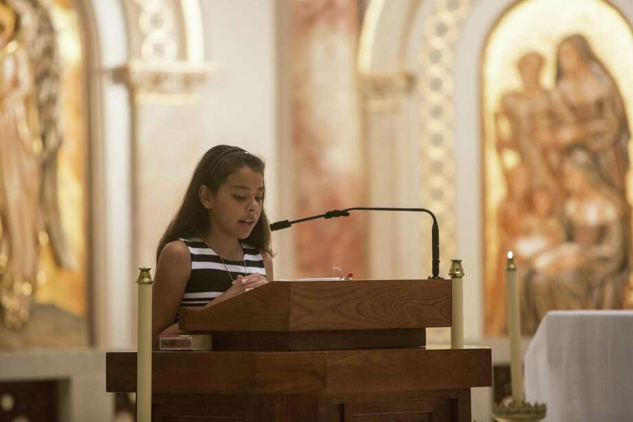 Mia Alcozer, 11, speaks during the partnership celebration Mass for the community health care initiative between Southside ISD and UIW's School of Osteopathic Medicine on Aug. 5, 2017. Photo: Carolyn Van Houten /San Antonio Express-News / 2017 San Antonio Express-News