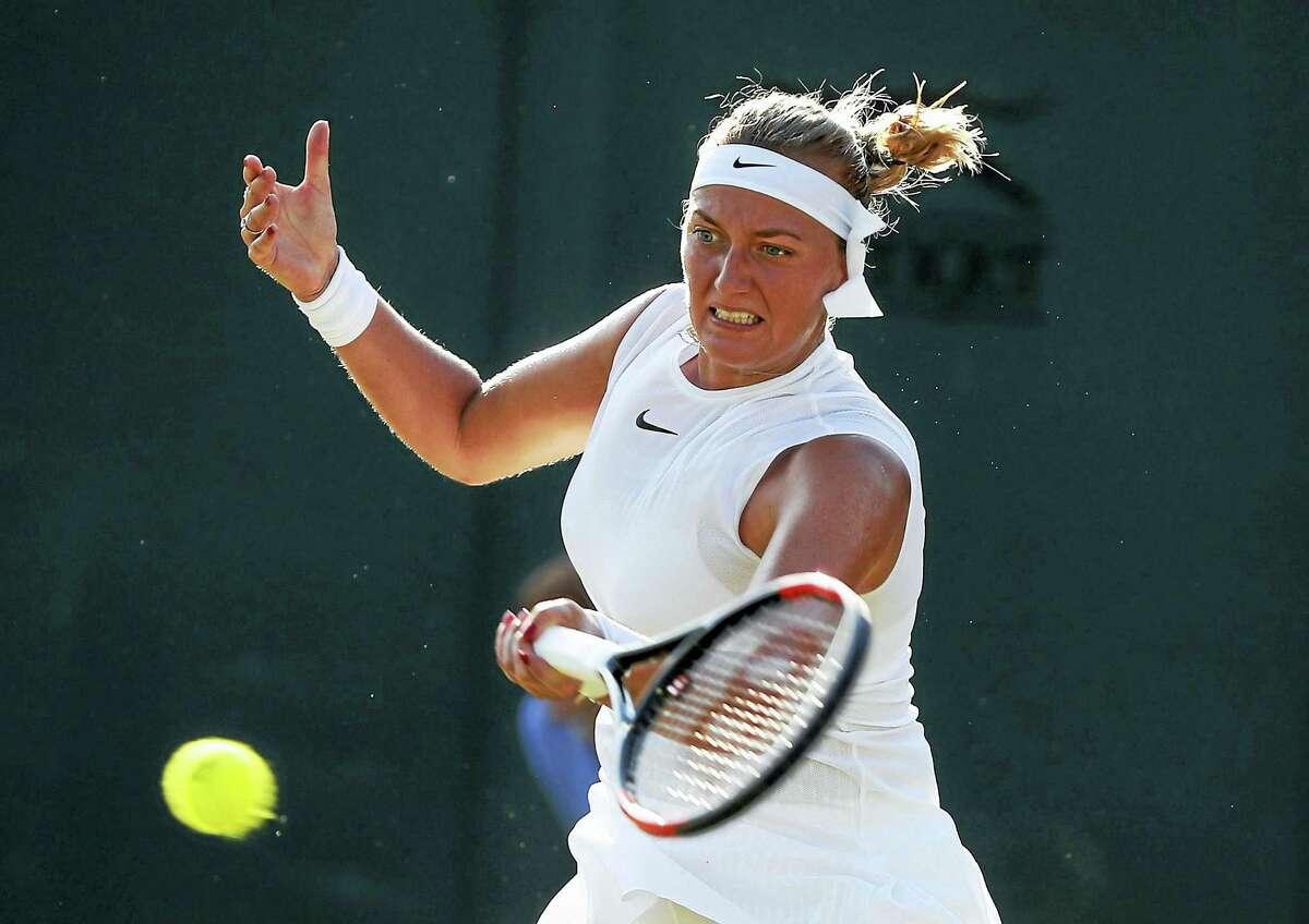 Petra Kvitova returns a shot during a match at Wimbledon earlier this year.