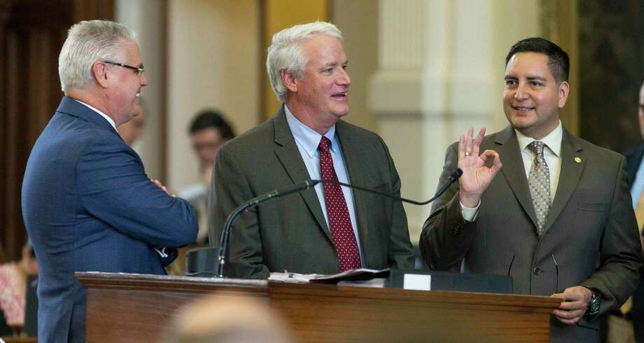 State Reps. Dan Huberty (from left), R-Houston, Lyle Larson, R-San Antonio, and Philip Cortez, D-San Antonio, speak during Monday's debate of the municipal annexation bill on the House floor. Photo: Stephen Spillman /For The San Antonio Express-News / stephenspillman@me.com Stephen Spillman