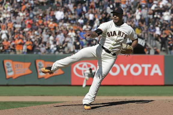 San Francisco Giants pitcher Albert Suarez throws against the Arizona Diamondbacks during the ninth inning of a baseball game in San Francisco, Sunday, Aug. 6, 2017. The Giants won 6-3. (AP Photo/Jeff Chiu)
