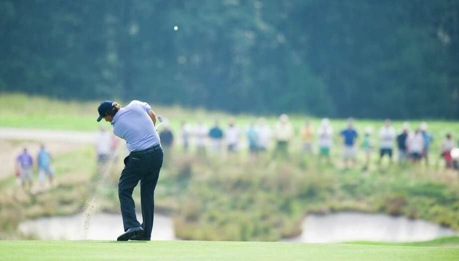 Phil Mickelson hits a shot during 3rd round play of the 2012 Barclays on the Black Course at Bethpage State Park. (Ron Antonelli/ New York Daily News) Photo: Ron Antonelli / 2012/Daily News, L.P. (New York)
