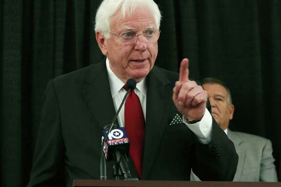 In this Nov. 10, 2016 photo, former Texas Gov. Mark White points to an audience of Baylor University alumni who gathered for a press conference demanding reform concerning the ongoing campus-wide sexual assault scandal, in Waco, Texas. White, a Democrat who championed public education reforms, has died. He was 77. His wife, Linda, said White died Saturday, Aug. 5, 2017. White served as governor from 1983 until 1987.  (Rod Aydelotte/Waco Tribune-Herald via AP)