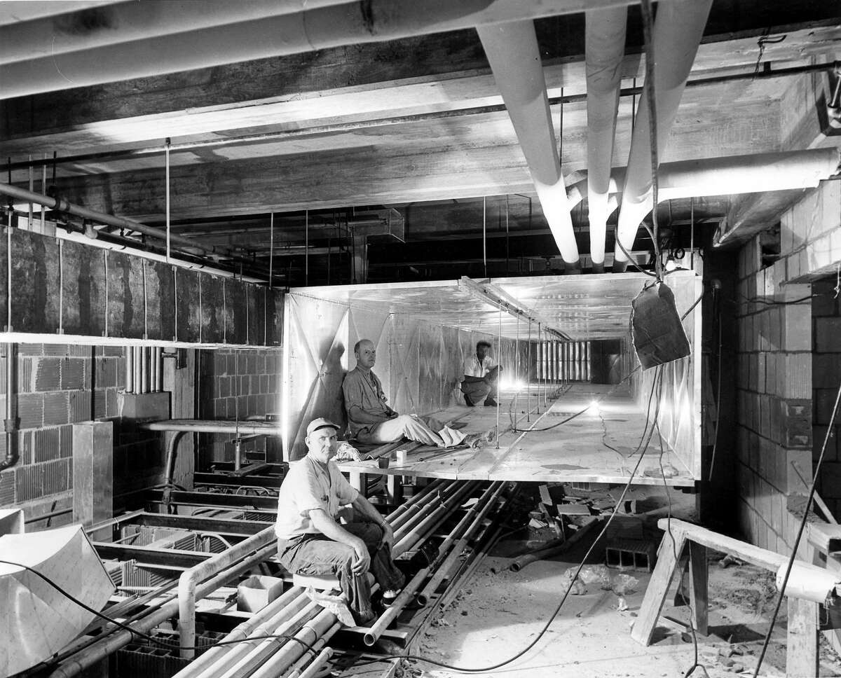 TRUMAN-ERA RENOVATIONS Workers pose inside air ducts during extensive work on the White House on July 19, 1951. Courtesy National Archives.