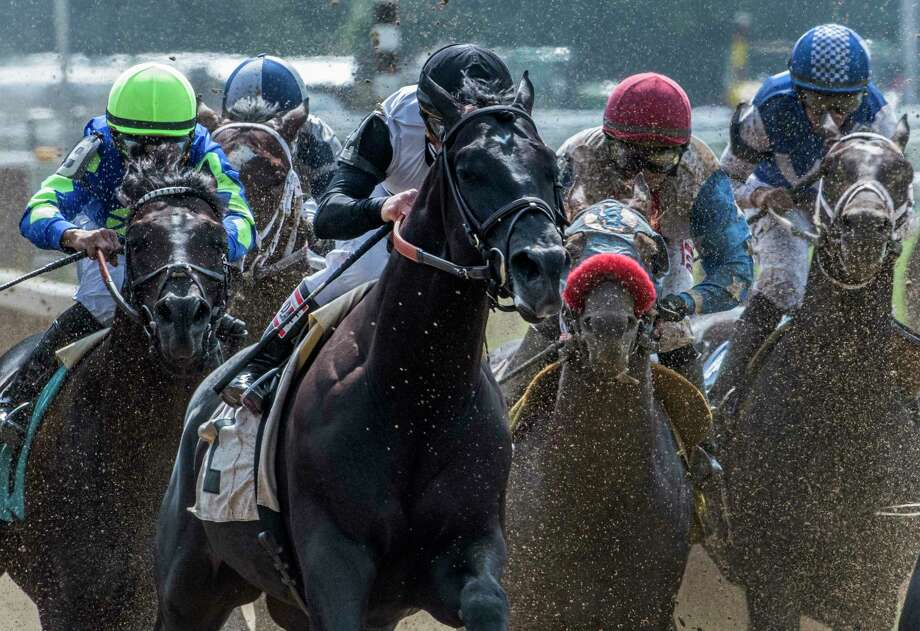 #2 Barely Impazible ridden by jockey Javier Castellano works through a wall of dirt spray from horses ahead of him to make the lead and to become the eventual winner of the 6th race on the card at the Saratoga Race Course Monday Aug. 7, 2017 in Saratoga Springs, N.Y.  (Skip Dickstein/Times Union) Photo: SKIP DICKSTEIN