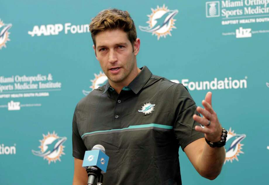 New Miami Dolphins quarterback Jay Cutler speaks at a news conference during an NFL football training camp, Monday, Aug. 7, 2017, in Davie, Fla. Cutler has agreed to terms on a $1 million, one-year contract, as starting quarterback Ryan Tannehill remains out with a left knee injury. (AP Photo/Lynne Sladky) ORG XMIT: FLLS109 Photo: Lynne Sladky / Copyright 2017 The Associated Press. All rights reserved.