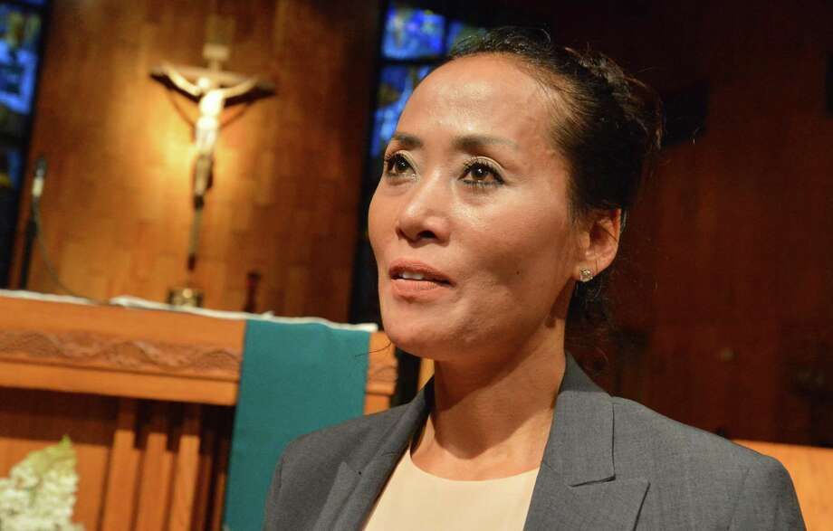 Jung Courville talks about not wanting to be deported to Korea after a prayer vigil in support of her and her family.  at St. Jerome Church on Monday August 7, 2017 in Norwalk Conn. Courville is a Korean immigrant mother who was recently ordered deported by ICE, she has been in the US for 18 years, married to a US citizen for 14 years, and has two US citizen children. Photo: Alex Von Kleydorff / Hearst Connecticut Media / Norwalk Hour