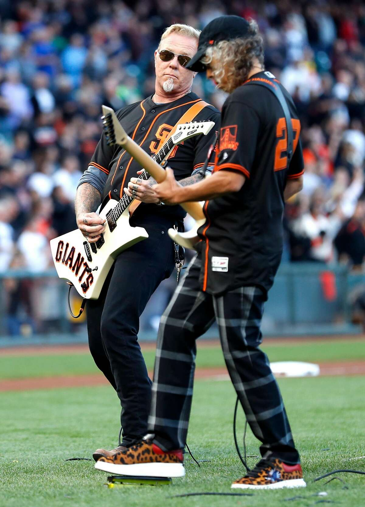 Metallica's James Hatfield and Kirk Hammett perform National Anthem before San Francisco Giants play Chicago Cubs during MLB game at AT&T Park in San Francisco, Calif. on Monday, August 7, 2017.