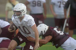 Colby Standard runs the ball during the first day of Lee football practice Aug. 7, 2017. James Durbin/Reporter-Telegram
