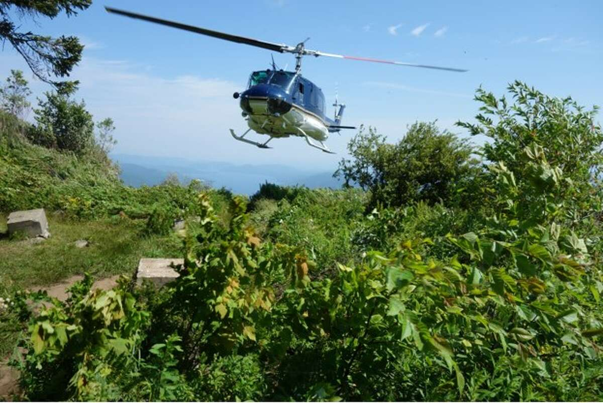 Tony Solomon and his friend Joe Busch climbed Black Mountain over looking Lake George Aug. 3, 2017, and watched as a State Police helicopter approached on the summit.