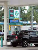 Katie Leonard fills up at the Easy Lane Food Mart and Valero on Louetta. Gasoline prices have been rising, but prices usually fall later in the year as demand eases and refiners shift to cheaper winter-grade gasoline.