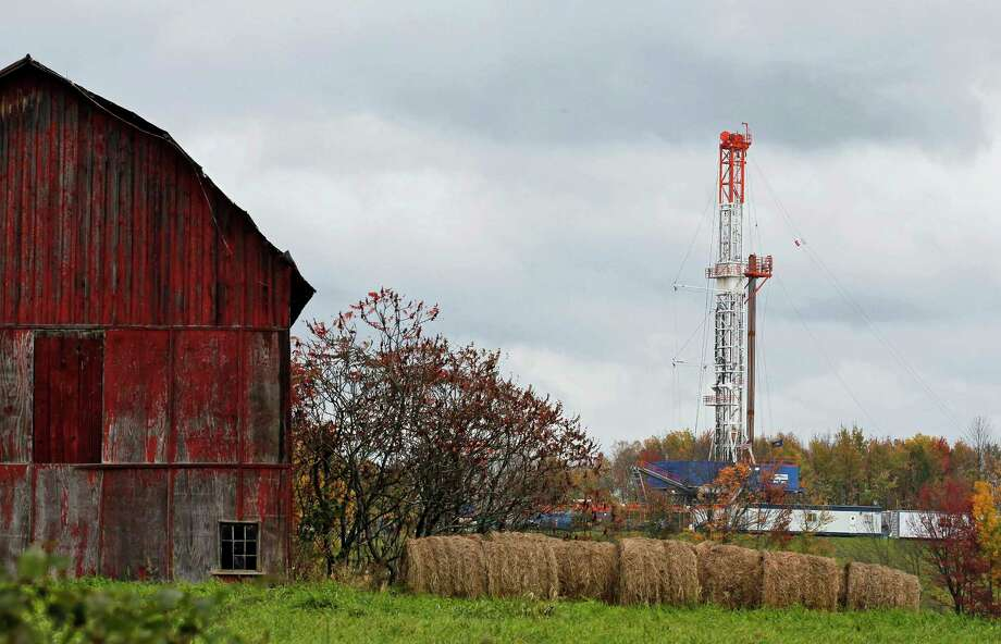 FILE – In this Oct. 14, 2011, file photo, a drilling rig is set up to tap gas from the Marcellus Shale gas field, near a barn in the Susquehanna County township of Springville, Pa. Natural gas producers drilled more than twice as many shale wells in the first half of 2017 compared to the same period last year. One big reason is that natural gas prices have recovered from 20-year lows, nearly doubling since last year. Three counties, Washington, Greene and Susquehanna, account for more than 60 percent of the wells drilled so far this year. (AP Photo/Alex Brandon, File) Photo: Alex Brandon, STF / Copyright 2017 The Associated Press. All rights reserved.