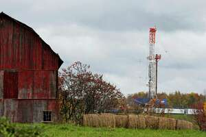 FILE – In this Oct. 14, 2011, file photo, a drilling rig is set up to tap gas from the Marcellus Shale gas field, near a barn in the Susquehanna County township of Springville, Pa. Natural gas producers drilled more than twice as many shale wells in the first half of 2017 compared to the same period last year. One big reason is that natural gas prices have recovered from 20-year lows, nearly doubling since last year. Three counties, Washington, Greene and Susquehanna, account for more than 60 percent of the wells drilled so far this year. (AP Photo/Alex Brandon, File)