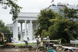 Construction workers work on the North Lawn of the White House August 10, 2012 in Washington, DC.  The construction is part ongoing infrastructure upgrades on the White House campus.  AFP PHOTO/Brendan SMIALOWSKI        (Photo credit should read BRENDAN SMIALOWSKI/AFP/GettyImages)
