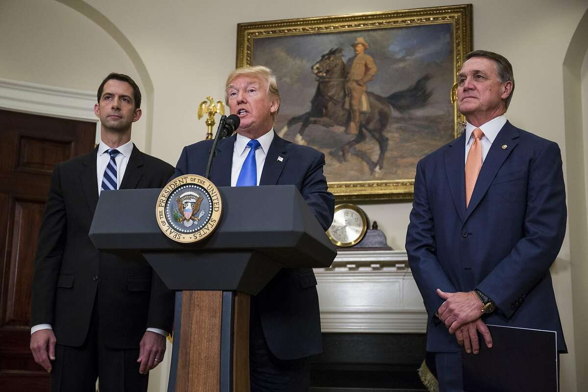 U.S. President Donald Trump makes an announcement on the introduction of the Reforming American Immigration for a Strong Economy (RAISE) Act with Sen. Tom Cotton (R-AR) left, and Sen. David Perdue (R-GA) right, in the Roosevelt Room at the White House on August 2, 2017 in Washington, DC. The act aims to overhaul U.S. immigration by moving towards a