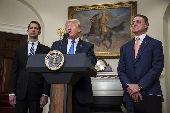 "WASHINGTON, DC - AUGUST 2: (AFP OUT) U.S. President Donald Trump makes an announcement on the introduction of the Reforming American Immigration for a Strong Economy (RAISE) Act with Sen. Tom Cotton (R-AR) left, and Sen. David Perdue (R-GA) right, in the Roosevelt Room at the White House on August 2, 2017 in Washington, DC. The act aims to overhaul U.S. immigration by moving towards a ""merit-based"" system. (Photo by Zach Gibson - Pool/Getty Images)"