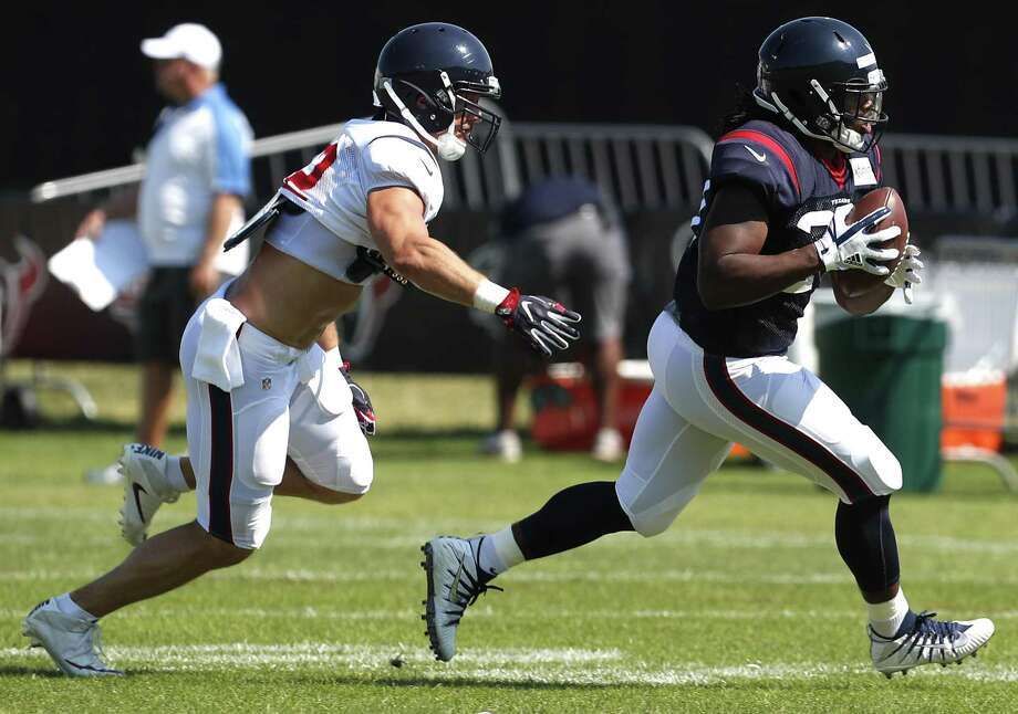 Houston Texans running back D'Onta Foreman (27) runs with the ball with linebacker Brian Peters (52) defending during training camp at the Greenbrier on Aug. 4, 2017, in White Sulphur Springs, W.Va. Photo: Brett Coomer /Houston Chronicle / © 2017 Houston Chronicle}