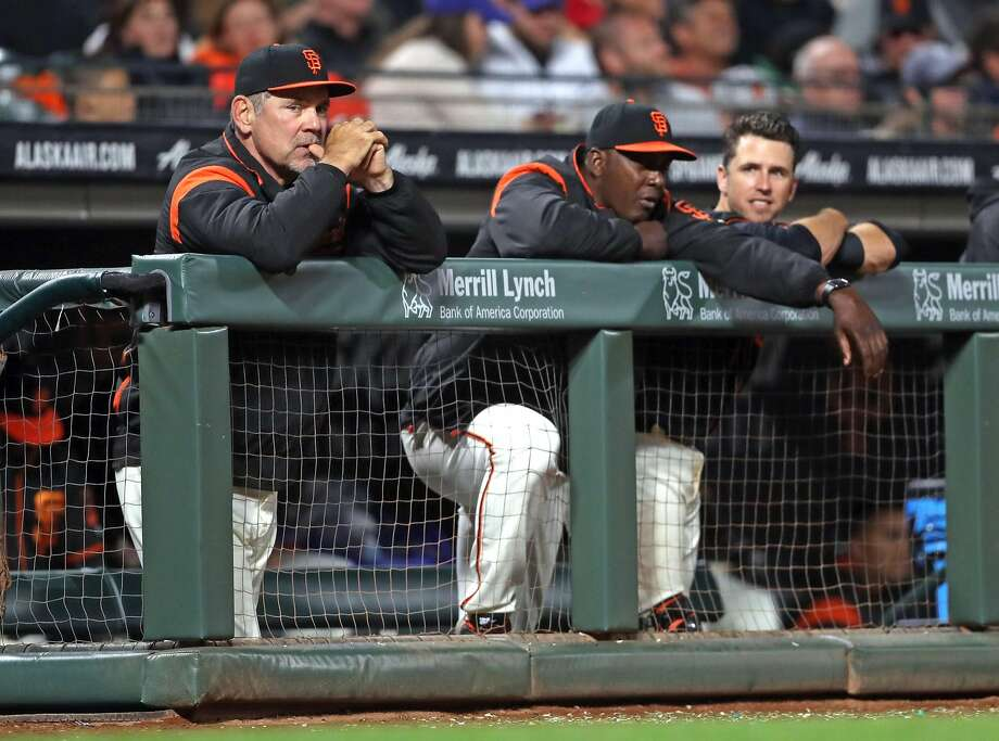 San Francisco Giants' manager Bruce Bochy, hitting coach Hensley Meulens and Buster Posey watch a game against theChicago Cubs at AT&T Park on August 7, 2017. Photo: Scott Strazzante, The Chronicle
