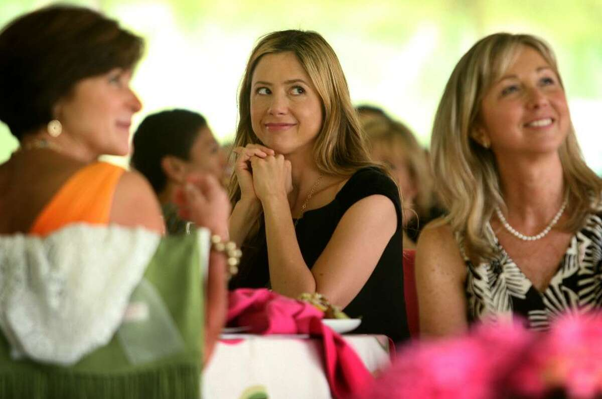 Actress Mira Sorvino, center, sits with Donna Twist, right, executive director of the Norma F. Pfriem Breast Care Center at Bridgeport Hospital, during Wednesday's Rose of Hope luncheon at the home of Tom and Patti Keegan in the Greenfield Hill section of Fairfield.