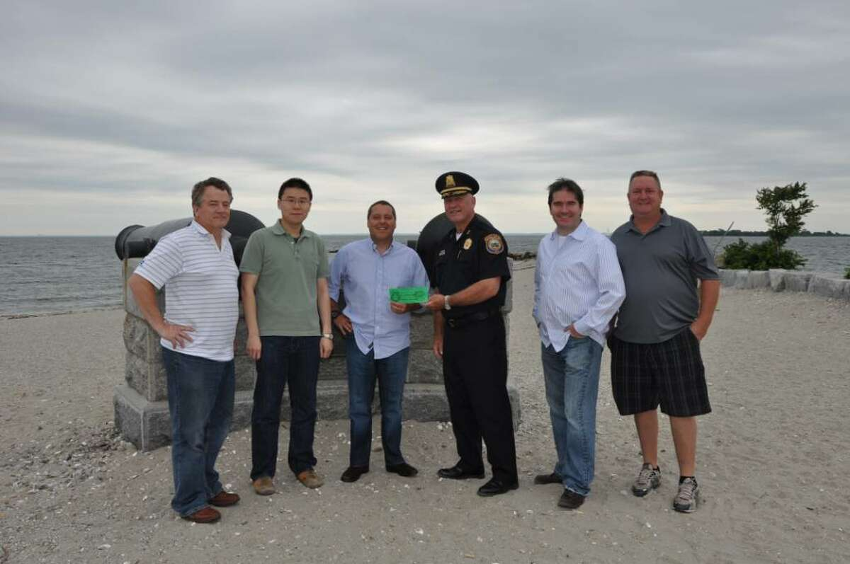 PAL President, Police Chief Al Fiore, third from right, is shown presenting ticket No. 1 to Dave Friezo, third from left, of Lydian. Also pictured from the Lydian staff, from left to right, are Jim Oakley, Bing Cui, Tom Kennedy and Scott Rochlin.