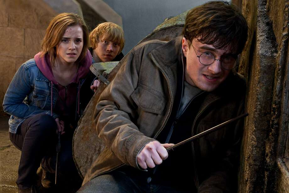 "In this film publicity image released by Warner Bros. Pictures, from left, Emma Watson, Rupert Grint and Daniel Radcliffe are shown in a scene from ""Harry Potter and the Deathly Hallows: Part 2."" (AP Photo/Warner Bros. Pictures, Jaap Buitendijk) Photo: Jaap Buitendijk, AP"