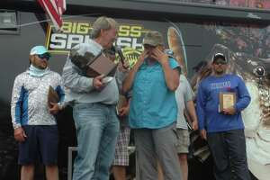 Tonja Woytasczyk wiped tears after being the first female angler to be crowned champion of the Big Bass Splash.