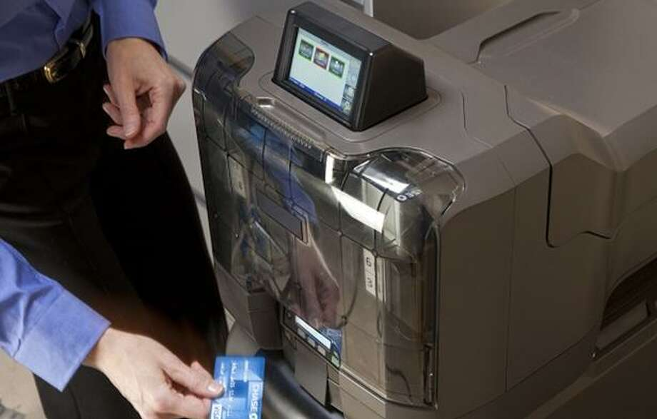 "An ""instant issue"" machine debuting in 2012 at JPMorgan Chase, allowing branches to issue replacement debit cards to customers on the spot. The bank discontinued using the machines in 2017, according to the Wall Street Journal. (File photo via Business Wire)"