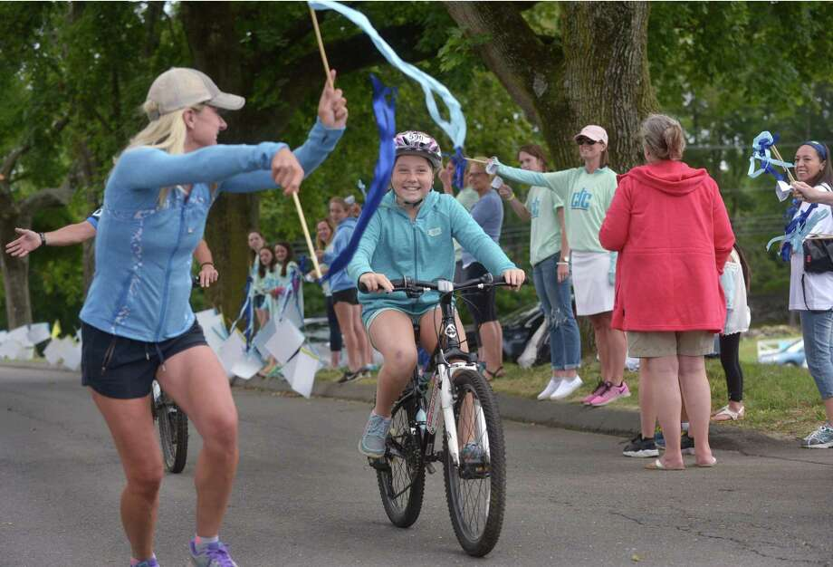 Fairfield resident Kate Richards, 10, is cheered on by her mom, Susie Richards, as she completes the 2017 CT Challenge Bicycle Ride Saturday at the Fairfield County Hunt Club in Westport. Photo: Erik Trautmann / Hearst Connecticut Media / Norwalk Hour