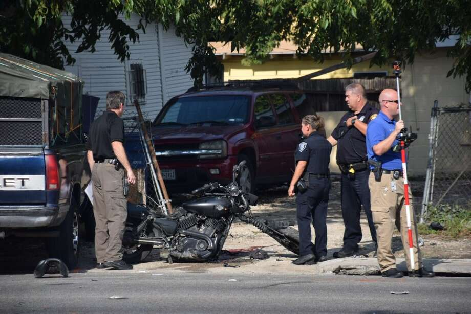 A motorcyclist suffered life-threatening injuries Tuesday, August 8, 2017, when he crashed into the side of a pickup truck without a helmet on. Photo: Caleb Downs / San Antonio Express-News