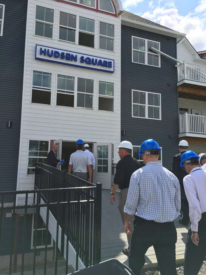 Officials get a look at construction progress at the $25 million Hudson Square apartment complex on Van Schaick Island in Cohoes Tuesday morning. (Eric Anderson/Times Union)