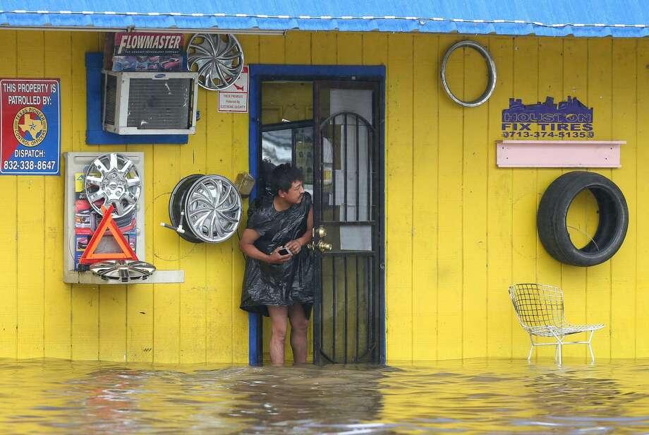 A man looks out a door at the flooded West Mount Houston Road Tuesday, Aug. 8, 2017, in Houston. ( Godofredo A. Vasquez / Houston Chronicle ) Photo: Godofredo A. Vasquez
