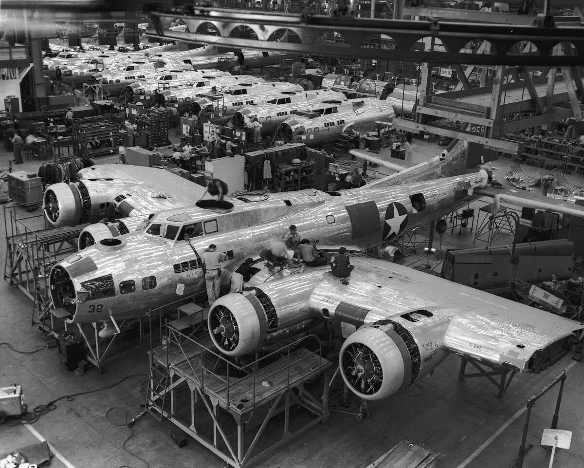 Circa 1942: People working on a B-17 Flying Fortress plane and plane parts under construction at the Lockheed plant in Burbank, California, World War II. (Photo by Anthony Potter Collection/Getty Images)