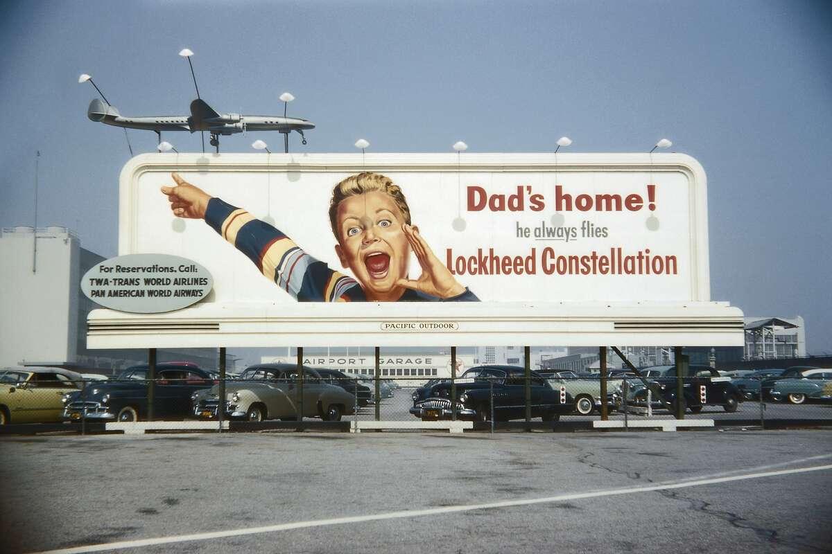 1950's TWA Lockheed billboard with excited boy (Photo by Gary Leonard/Corbis via Getty Images)