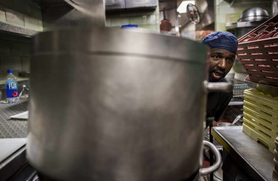 Dishwasher Abdoul Sylla works in the kitchen of Daniel, one of chef Daniel Boulud's restaurants in New York. Washington Post photo by Melina Mara. Photo: Melina Mara/The Washington Post