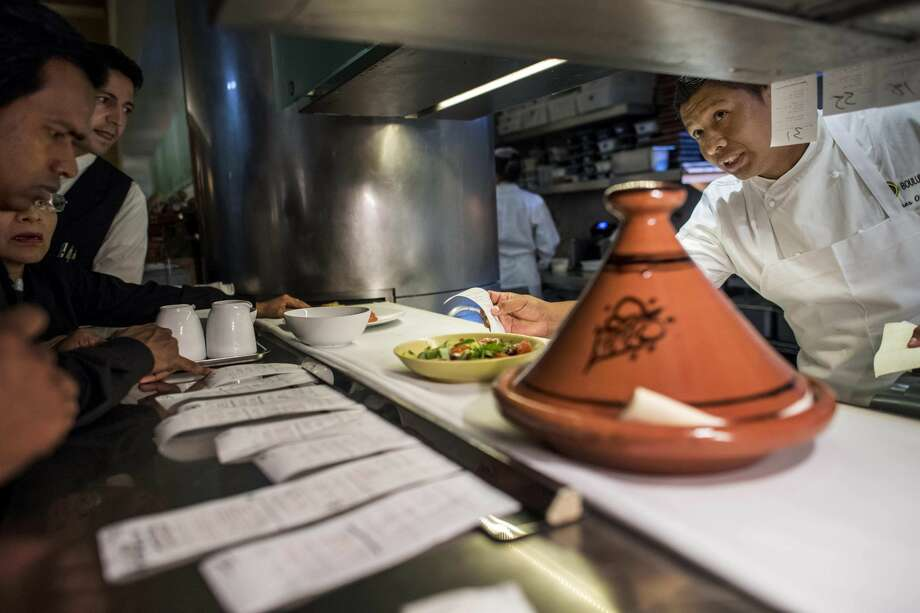 Ulises Olmos, an executive sous chef, works the line during dinner service at Boulud Sud in Manhattan. Olmos began as a dishwasher at Cafe Boulud in 2005. Washington Post photo by Melina Mara. Photo: Melina Mara/The Washington Post