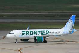 A Frontier Airlines Airbus taxis after landing at Bush Intercontinental Airport in February 2017.